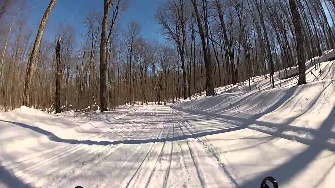 Snowmobilers enjoy the well-maintained trails near Clam Lake. Ashland County offers more than 220 miles of groomed snowmobile trails.